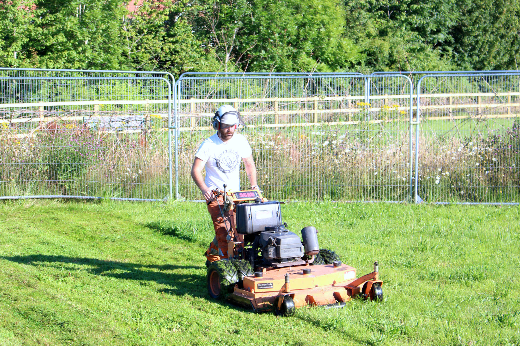 Gentleman Mowing Grass